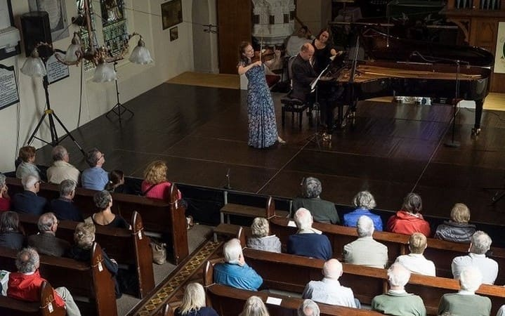 Tamsin Waley-Cohen and audience in St Brendans Church